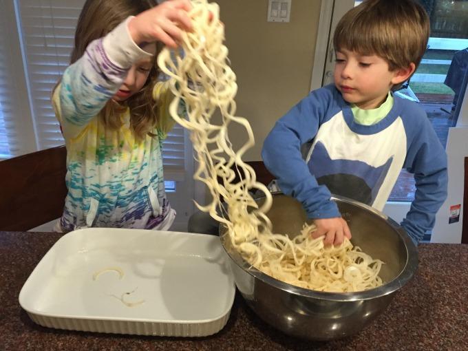 Putting potatoes in baking dish