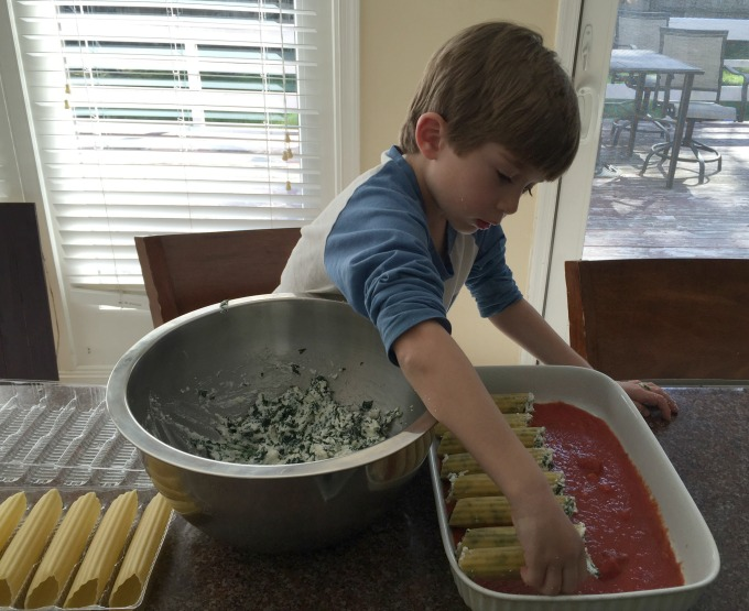Placing Manicotti in Dish