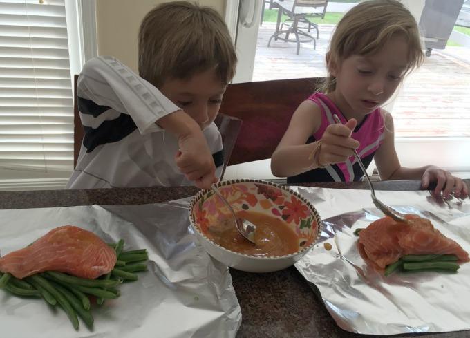 Spooning marinade over fish
